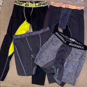 Bundle of four men's workout tights